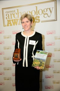 Rebecca Jones, with her award-winning book and prize, as the winner of 2013′s Book of the Year at the prestigious Current Archaeology Awards