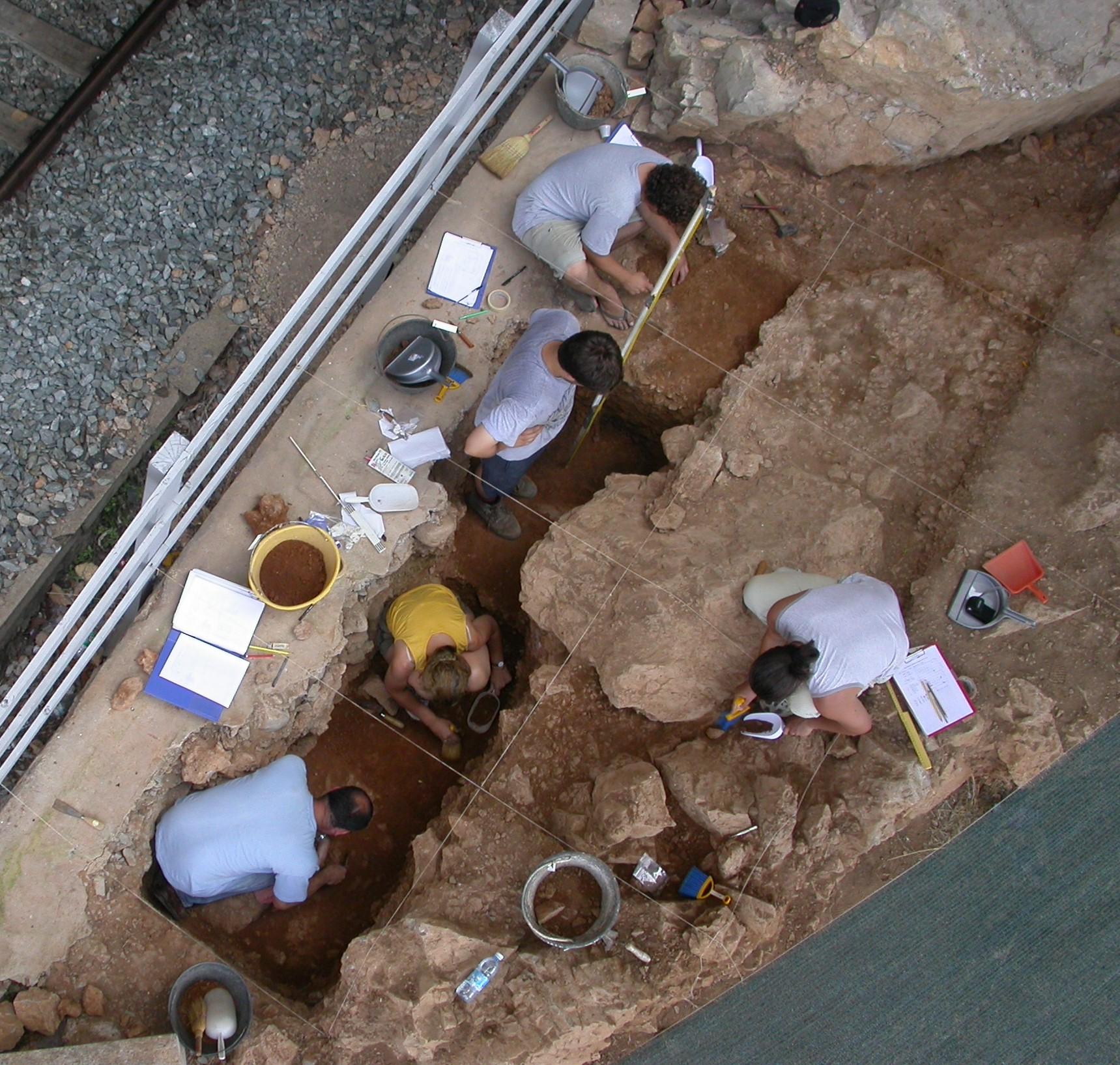 Archeologists are shown excavating Neanderthal levels at Riparo Bombrini, Northwest Italy. Credit: Fabio Negrino
