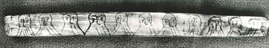 Mystery nosed out ... Fragment of wooden stick with runic inscription on one side found at the old wharf in Bergen. The text is written using a code where the number of 'hairs' in the beards of each face indicate the position of the character in the runic alphabet. Museum of cultural history, University of Oslo. Aslak Liestol Photograph: Aslak Liestol/Museum of Cultural History, University of Oslo